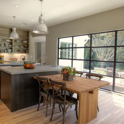Example of a transitional eat-in kitchen design in Atlanta with open cabinets, beige cabinets, white backsplash and stainless steel appliances