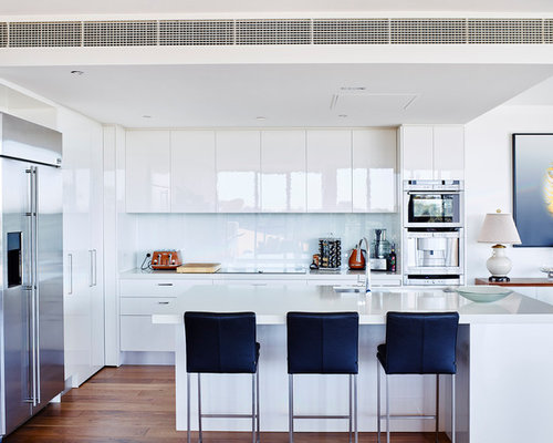 Contemporary Kitchen Idea In Melbourne With An Undermount Sink, Flat Panel  Cabinets, White