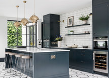 I'd love to know what floor tile that is. Would you please share?