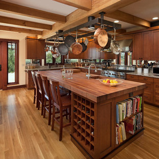 Inspiration for a mid-sized arts and crafts l-shaped separate kitchen in Santa Barbara with stainless steel appliances, recessed-panel cabinets, medium wood cabinets, mirror splashback, medium hardwood floors and with island.
