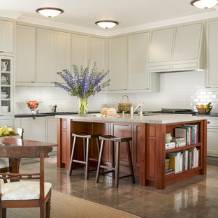 Large traditional eat-in kitchen appliance - Eat-in kitchen - large traditional eat-in kitchen idea in San Francisco with an undermount sink, raised-panel cabinets, gray cabinets, quartz countertops, white backsplash, subway tile backsplash, paneled appliances and an island