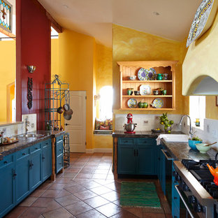 Tuscan kitchen photo in Santa Barbara with stainless steel appliances