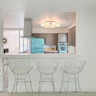 Inspiration for a small midcentury u-shaped open plan kitchen in Phoenix with flat-panel cabinets, grey cabinets, quartz benchtops, orange splashback, porcelain splashback, coloured appliances and concrete floors.