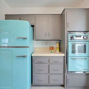 Design ideas for a small midcentury u-shaped open plan kitchen in Phoenix with an integrated sink, flat-panel cabinets, grey cabinets, tile benchtops, orange splashback, porcelain splashback, coloured appliances and concrete floors.