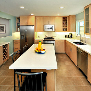Contemporary l-shaped eat-in kitchen in Los Angeles with stainless steel appliances, an undermount sink, flat-panel cabinets, light wood cabinets, quartz benchtops, beige splashback, porcelain splashback, ceramic floors and with island.