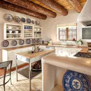 Southwestern kitchen photos - Kitchen - southwestern u-shaped kitchen idea in Albuquerque with open cabinets, white cabinets and an island