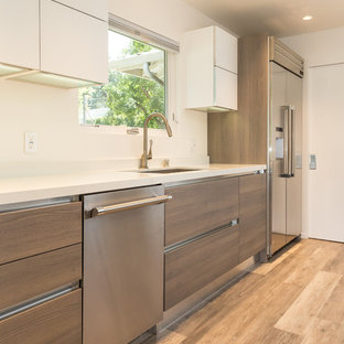 Mid-sized modern eat-in kitchen pictures - Mid-sized minimalist l-shaped laminate floor and beige floor eat-in kitchen photo in San Francisco with an undermount sink, flat-panel cabinets, light wood cabinets, quartz countertops, white backsplash, glass tile backsplash, stainless steel appliances and an island