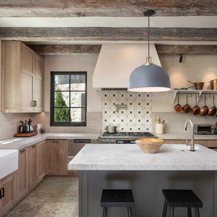 Large mediterranean l-shaped separate kitchen in San Francisco with ceramic floors, beige floor, a farmhouse sink, beaded inset cabinets, beige cabinets, granite benchtops, beige splashback, terra-cotta splashback, stainless steel appliances, with island and grey benchtop.