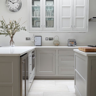 Kitchen Transitional Idea In London With Shaker Cabinets White And An Island