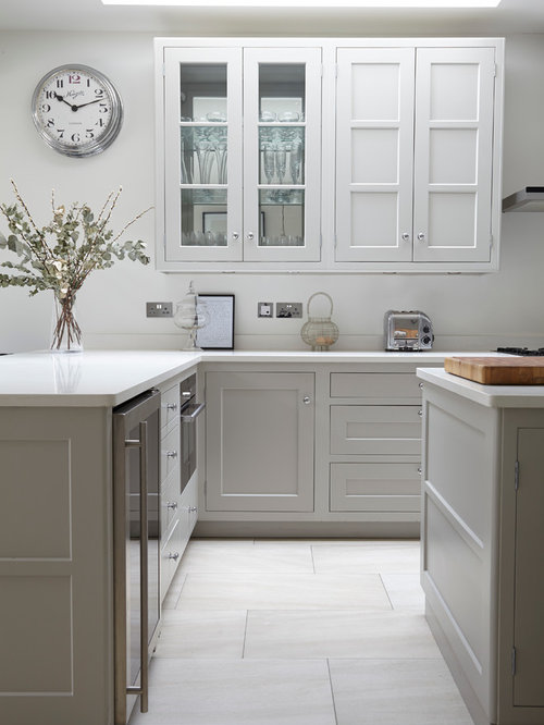 Awesome Traditional Kitchen In London With Shaker Cabinets, White Cabinets And An  Island.
