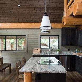 Idéer för att renovera ett rustikt grå grått kök, med en undermonterad diskho, skåp i shakerstil, skåp i mörkt trä, stänkskydd i trä, rostfria vitvaror, mörkt trägolv, en köksö och brunt golv