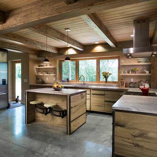 Rustic kitchen designs - Kitchen - rustic concrete floor and gray floor kitchen idea in Bridgeport with an undermount sink, open cabinets, window backsplash and an island