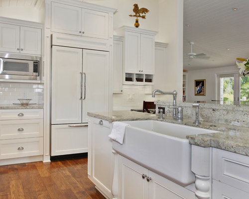 traditional kitchen idea in san diego with subway tile backsplash a farmhouse sink and paneled
