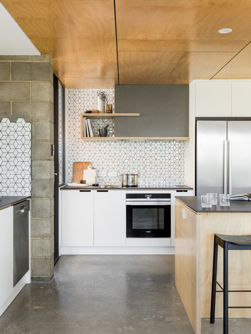 Inspiration For An Expansive Scandi Galley Open Plan Kitchen In Adelaide  With Flat Panel Cabinets