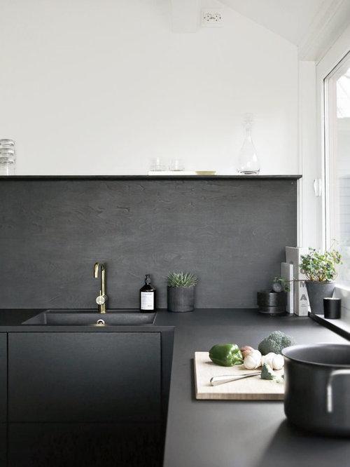 Small scandinavian kitchen appliance - Small danish u-shaped light wood  floor kitchen photo in
