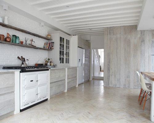 Scandinavian Single Wall Eat In Kitchen Idea In London With Flat Panel  Cabinets