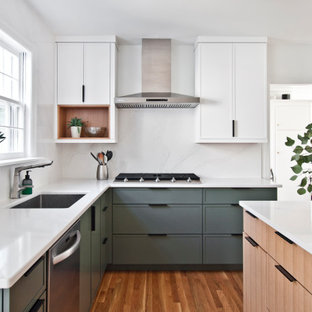 Inspiration for a mid-sized scandinavian l-shaped eat-in kitchen in Nashville with an undermount sink, flat-panel cabinets, yellow cabinets, quartz benchtops, white splashback, stone slab splashback, stainless steel appliances, medium hardwood floors, with island, orange floor and white benchtop.
