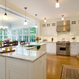 Traditional eat-in kitchen photos - Elegant u-shaped eat-in kitchen photo in New York with an undermount sink, shaker cabinets, white cabinets and paneled appliances