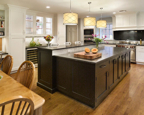lighting over a kitchen island. traditional eatin kitchen idea in new york with shaker cabinets dark wood lighting over a island e