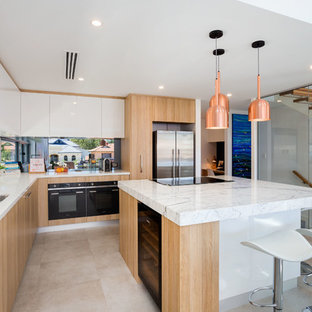 Design ideas for a contemporary l-shaped separate kitchen in Perth with a double-bowl sink, flat-panel cabinets, white cabinets, marble benchtops, glass sheet splashback, stainless steel appliances and with island.