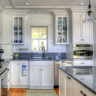 Inspiration for a beach style kitchen in Bridgeport with an undermount sink, shaker cabinets, white cabinets, stainless steel appliances, medium hardwood floors, with island and blue benchtop.