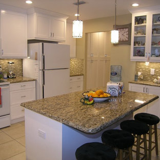 Design ideas for a mid-sized traditional u-shaped eat-in kitchen in Tampa with a double-bowl sink, shaker cabinets, white cabinets, granite benchtops, green splashback, matchstick tile splashback, stainless steel appliances, ceramic floors and with island.