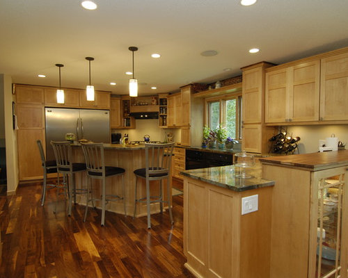Traditional kitchen idea in Minneapolis with glass-front cabinets,  stainless steel appliances, medium - Light Cabinets Dark Floors Houzz