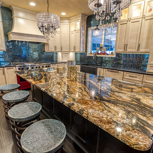 Large eclectic l-shaped separate kitchen in Philadelphia with a farmhouse sink, recessed-panel cabinets, white cabinets, granite benchtops, blue splashback, glass tile splashback, coloured appliances, porcelain floors, with island, black floor and black benchtop.
