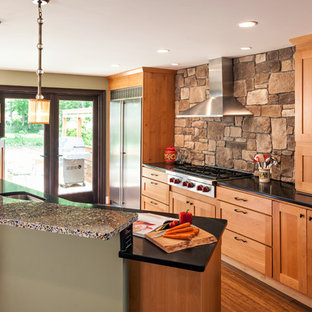 Design ideas for a mid-sized transitional kitchen pantry in Boston with shaker cabinets, medium wood cabinets, recycled glass benchtops, brown splashback and with island.