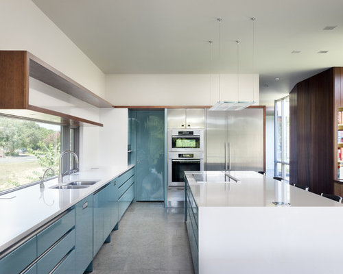 Example Of A 1950s Kitchen Design In Austin With Stainless Steel Liances Quartz Countertops
