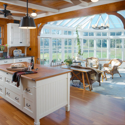 Example of a classic kitchen design in Providence with wood countertops