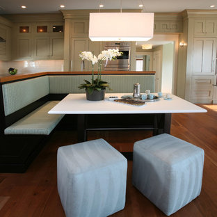 Coastal open concept kitchen inspiration - Beach style open concept kitchen photo in Philadelphia with shaker cabinets and beige cabinets