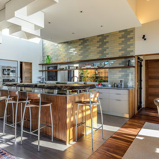 Example of a 1960s u-shaped eat-in kitchen design in San Francisco with stainless steel appliances, open cabinets, wood countertops and multicolored backsplash