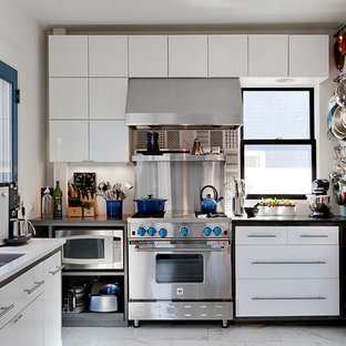 Kitchen - modern u-shaped kitchen idea in Boston with a double-bowl sink, flat-panel cabinets, white cabinets, metallic backsplash, metal backsplash and stainless steel appliances
