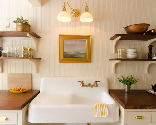 example of a coastal ushaped eatin kitchen design in portland with a