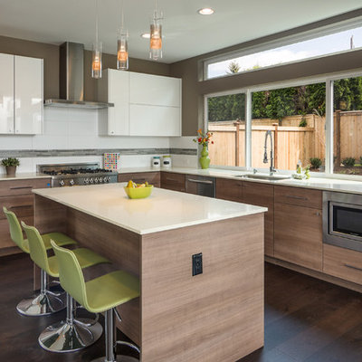 Trendy l-shaped dark wood floor kitchen photo in Seattle with an undermount sink, flat-panel cabinets, medium tone wood cabinets, white backsplash, stainless steel appliances and an island
