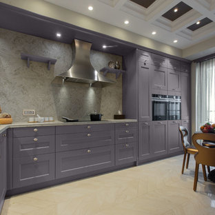 This is an example of a large eclectic l-shaped open plan kitchen in Other with a double-bowl sink, louvered cabinets, purple cabinets, quartz benchtops, beige splashback, stone slab splashback, coloured appliances, ceramic floors, a peninsula, beige floor and beige benchtop.