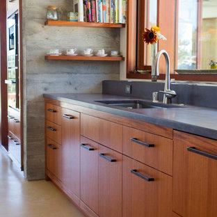 サンフランシスコの大きいアジアンスタイルのおしゃれなアイランドキッチン (コンクリートカウンター、シルバーの調理設備の、コンクリートの床) の写真