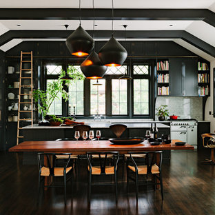 Example of a classic dark wood floor open concept kitchen design in Portland with shaker cabinets, gray cabinets, marble countertops, stone tile backsplash, paneled appliances, an island and black backsplash