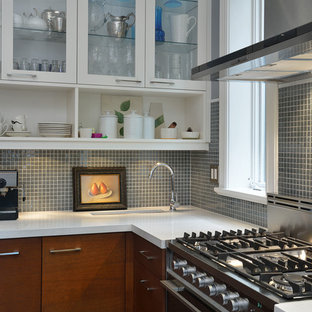 Inspiration for a contemporary kitchen in Toronto with glass-front cabinets, white cabinets and grey splashback.