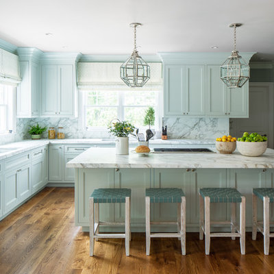 Inspiration for a timeless l-shaped medium tone wood floor kitchen remodel in Denver with an undermount sink, shaker cabinets, blue cabinets, marble countertops, white backsplash, marble backsplash, paneled appliances, an island and white countertops