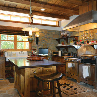 Rustic eat-in kitchen designs - Mountain style l-shaped limestone floor eat-in kitchen photo in Los Angeles with flat-panel cabinets, medium tone wood cabinets, concrete countertops, stainless steel appliances and an island