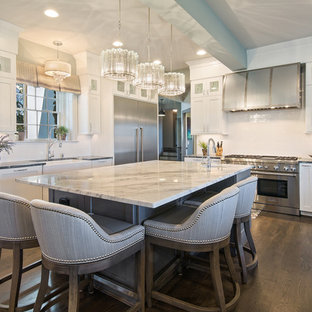 Mid-sized transitional eat-in kitchen pictures - Inspiration for a mid-sized transitional l-shaped dark wood floor eat-in kitchen remodel in Cincinnati with shaker cabinets, white cabinets, soapstone countertops, white backsplash, subway tile backsplash, stainless steel appliances, an island and a farmhouse sink