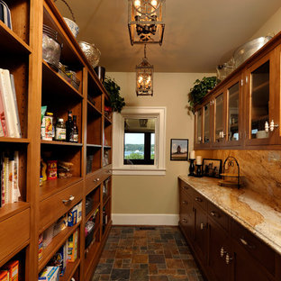 This is an example of a medium sized eclectic galley kitchen pantry in Baltimore with shaker cabinets, medium wood cabinets, granite worktops, beige splashback, stone slab splashback and slate flooring.