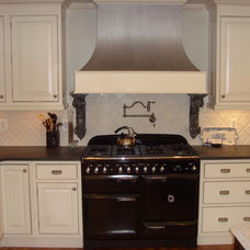 Traditional Kitchen by Caliber Home Restoration