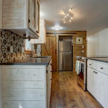 Shabby Chic Craftsman Kitchen with Sliding Barn Door