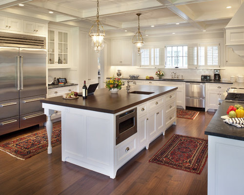 elegant ushaped kitchen photo in boston with cabinets stainless steel