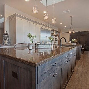 Design ideas for a large transitional open plan kitchen in Sacramento with a farmhouse sink, shaker cabinets, grey cabinets, granite benchtops, multi-coloured splashback, stainless steel appliances, vinyl floors and multiple islands.