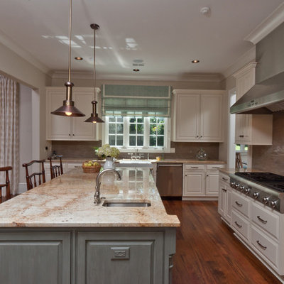 Kitchen - traditional kitchen idea in Other with raised-panel cabinets, white cabinets, beige backsplash and stainless steel appliances