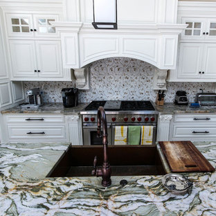Inspiration for a mid-sized contemporary single-wall open plan kitchen in Other with granite benchtops, with island, an undermount sink, raised-panel cabinets, white cabinets, multi-coloured splashback, porcelain splashback, stainless steel appliances, marble floors and white floor.